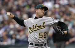 Athletics starting pitcher Justin Duchscherer allowed two Mariners hits over 7 1/3 innings to help Oakland start the season 6-2.