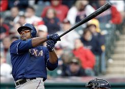 Nelson Cruz watches his 10th-inning two-run home run sail over the Progressive Field fence to propel the Rangers to victory.