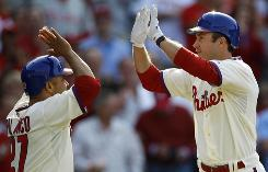 The Phillies' Chase Utley, right, is congratulated by Placido Polanco after hitting a home run in the fifth inning.