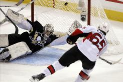 Pittsburgh Penguins goalie Marc-Andre Fleury, left, can't make the save on a goal by the Ottawa Senators' Erik Karlsson in the second period Wednesday.
