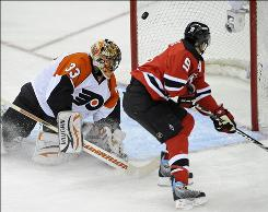 Zach Parise scored a first-period shorthanded goal as the Devils burned the Flyers in Game 2.