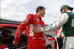 Kasey Kahne, left, and Dale Earnhardt Jr., chat after qualifying for Sunday's Samsung Mobile 500 race at Texas Motor Speedway. Kahne and Earnhardt are poised to become teammates at Hendrick Motorsports in 2012.