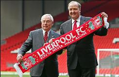 George Gillett, left, and Tom Hicks, posing with the Liverpool team scarf on Feb. 6, 2007, hope to sell the Premier League team for at least $770 million.