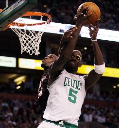 The Celtics' Kevin Garnett, getting fouled by the Heat's Joel Anthony while powering to the basket, recorded 15 points and nine rebounds to lead Boston to an 85-76 Game 1 win.