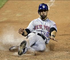 Angel Pagan scores the game-winning run on a sacrifice fly by Jose Reyes in the 20th inning as the Mets edged the Cardinals 2-1 in a game that lasted 6 hours, 53 minutes.