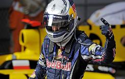 Sebastian Vettel of Germany celebrates after notching his third Formula One pole of the season, and the fourth of the year for the Red Bull team.