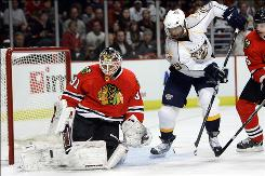 Blackhawks goalie Antti Niemi, trying to block a rebound from the Predators' Joel Ward during the first period, stopped all 23 Nashville shots to help Chicago draw even in the teams' Western Conference first-round series.