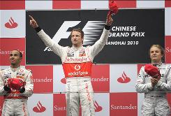 Jenson Button, center, celebrates his Chinese Grand Prix victory on the podium with second-place finisher Lewis Hamilton, left, and third-placed Nico Rosberg.