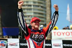 Ryan Hunter-Reay exults after taming Long Beach for the second IndyCar victory of his career.