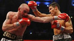 Sergio Martinez of Argentina, right, made a mess of Kelly Pavlik's face during their middlewieight title fight Saturday night in Atlantic City. Martinez won the title by unanimous decision.
