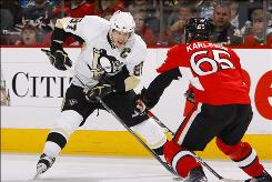 The Penguins' Sidney Crosby scored a goal and notched an assist as Pittsburgh took control of its Eastern Conference playoff series with Ottawa 2-1.