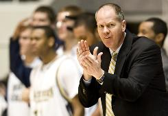 Tad Boyle cheers on his Northern Colorado team during a game on March 9. Boyle was hired Monday by the University of Colorado to become Jeff Bdzelik's successor as coach of the Buffaloes.