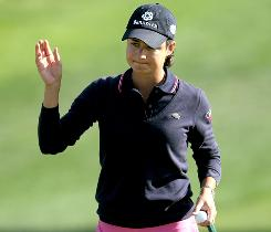 Lorena Ochoa waves to the gallery during the Kraft Nabisco Championship on April 2.