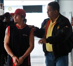 Venezuelan boxer Edwin Valero is taken into custody on Sunday.