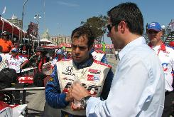 Driver Vitor Meira talks things over with team director Larry Foyt after Sunday's race at Long Beach.