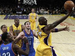 Lakers guard Kobe Bryant puts up a shot in traffic during the first half of Game 2 against the Thunder. Bryant scored 39 points as Los Angeles escaped with the win.