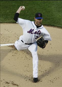 Mets starting pitcher Mike Pelfrey delivers in the second inning against the Cubs Tuesday night in New York. Pelfrey pitched seven scoreless innings.