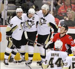 Sidney Crosby, center, scored twice as the Penguins moved to the cusp of advancing to the Eastern Conference semifinals with the Game 4 win and 3-1 series lead over the Senators.