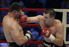 Poland's Tomasz Adamek, right, beating Andrew Golota on Oct. 24, is dedicating his Saturday fight to the memory of the 96 people who died in a plane crash, which included Poland's president.