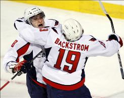 The Capitals' Alex Ovechkin celebrates with teammate Nicklas Backstrom after scoring the third goal against the Canadiens during the third period of Game 4 on Wednesday night in Montreal. The Capitals defeated the Canadiens 6-3 to take a 3-1 lead in the best-of-seven series.