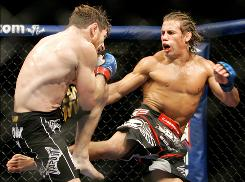 Urijah Faber, right, kicks Mike Brown during the second round of a World Extreme Cagefighting featherweight title fight in Sacramento on June 7, 2009. Faber is the nation's most popular lighter-weight mixed martial artist and the face of World Extreme Cagefighting, yet he's willing to take risks to become known beyond his relatively narrow world. The former champion realizes he could be fighting for his career when he meets Jose Aldo for the WEC's featherweight title this weekend in its first pay-per-view event.