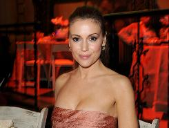 Alyssa Milano  a big sports fan  will work the red carpet during Thursday's draft coverage on ESPN and NFL Network.