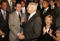 North Carolina Gov. Beverly Perdue, right, Duke University men's basketball coach Mike Krzyzewski, second left, and former NBA player Jerry West, center, all share a laugh Wednesday, April 21, 2010, in Raleigh, N.C., during a ceremony honoring at Duke for winning this year's NCAA title.