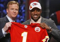 New Chiefs safety Eric Berry smiles with commissioner Roger Goodell after being selected by Kansas City.