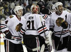 The Blackhawks congratulate goalie Antti Niemi after shutting out the Predators in Game 4.