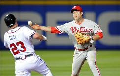Phillies second baseman Chase Utley can not turn a double play as a result of the slide of Atlanta Braves right fielder Matt Diaz, who barely avoids getting beaned in the head, in the fifth inning Thursday night in Atlanta.