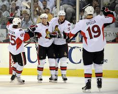 The Senators, celebrating teammate Peter Regin's third-period goal, avoided elimination and forced a Game 6 against the Penguins in Ottawa.