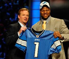 Ndamukong Suh meets with Roger Goodell after the Lions made him the second pick in the NFL draft.