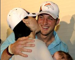 Denver Broncos first-round draft pick Tim Tebow is congratulated by his sister Katie Shepherd after being selected with the 25th pick in the NFL draft.