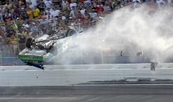 Carl Edwards flips into the catch fence on the final lap of the Aaron's 499 race at Talladega Superspeedway last year.