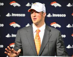 Tim Tebow arrived in Denver on Friday to begin his career with the Broncos.