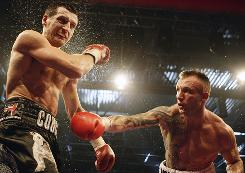 Mikkel Kessler throws a punch at Carl Froch during their title fight in Herning, Denmark. Kessler handed Froch his first professional loss to become the WBC super middleweight champion.