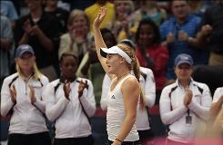 The USA's Melanie Oudin waves to fans following her 6-3, 6-3 win over Russia's Alla Kudryavtseva in a Fed Cup semifinal match in Birmingham, Ala.