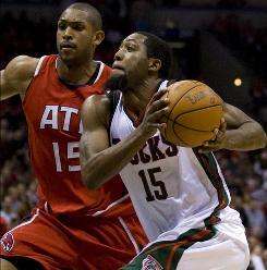 Bucks swingman John Salmons maneuvers past the Hawks' Al Horford during the third quarter. Salmons scored 22 points as Milwaukee won its first game of the series.