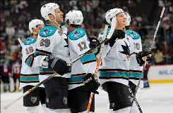 Ryane Clowe (29), Torrey Mitchell (17), Jamie McGinn (64) and the San Jose Sharks celebrate their 5-2 series-clinching victory over the Colorado Avalanche in Game 6.
