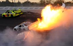 The car of Dennis Setzer, top right, gets airborne in a fireball in a multicar crash on the last lap at Talladega Superspeedway.