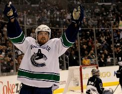 Vancouver's Daniel Sedin celebrates his go-ahead goal against the Kings with 2:03 left in the third period of Game 6. Sedin's Canucks won 4-2 to take the series and advance to the second round of the Western Conference playoffs for the third time in four seasons.