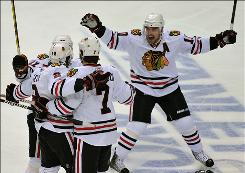 Five Blackhawks players, including Patrick Sharp, right, scored a goal to help Chicago subdue the Predators and advance to the Western Conference semifinals to face the Canucks.