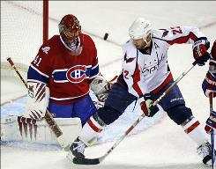 Canadiens goalie Jaroslav Halak, eyeing the puck in front of the Capitals' Mike Knuble, stopped 53 Washington shots to help Montreal force Game 7.