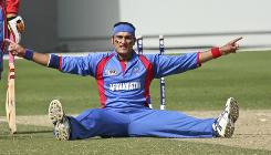 Afghanistan bowler Hamid Hassan celebrates during a February win against the USA. Hassan's father opposed him playing cricket when he was a boy but now wishes him well in the World Cup.