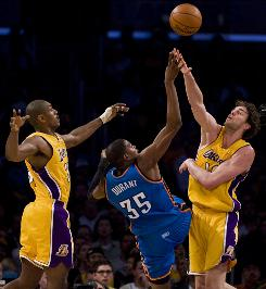 Los Angeles forward Pau Gasol blocks a shot by Oklahoma City Thunder forward Kevin Durant during first half action in game 5 of the their Western Conference playoff series at Staples Center. Gasol scored 25 points and Los Angeles held Durant to 17 points in a 111-87 victory.