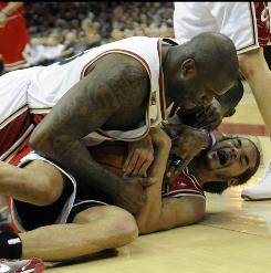 Chicago Bulls center Joakim Noah, bottom, struggles with Cleveland Cavaliers center Shaquille O'Neal for possession during the third quarter.
