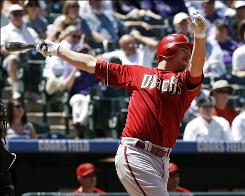 The Diamondbacks' Adam LaRoche follows through on a two-run double during the first inning. Arizona scored six runs in the top of the first.