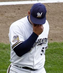 Brewers' Trevor Hoffman walks off the field after giving up the game-tying home run against the Pirates in the ninth inning.