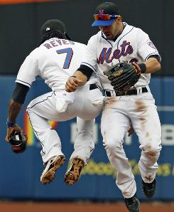 New York Mets' Jose Reyes, left, and Angel Pagan celebrate the Mets 7-3 victory over the Los Angeles Dodgers.