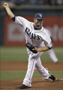 Starter James Shields struck out 12 and improved to 3-0 as the Rays routed the Athletics 10-3.